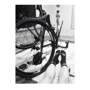 The deflating reality of changing a tyre at 4 am in the morning; black and white filter activated.