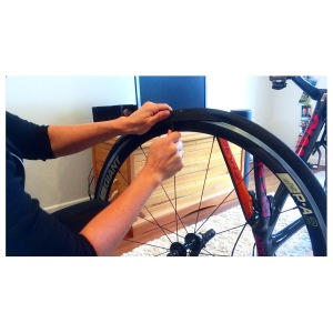 Levering the tyre off the rim