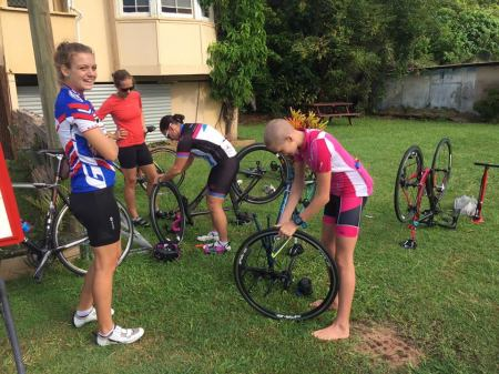Some of the ladies having a go at changing their tyre.